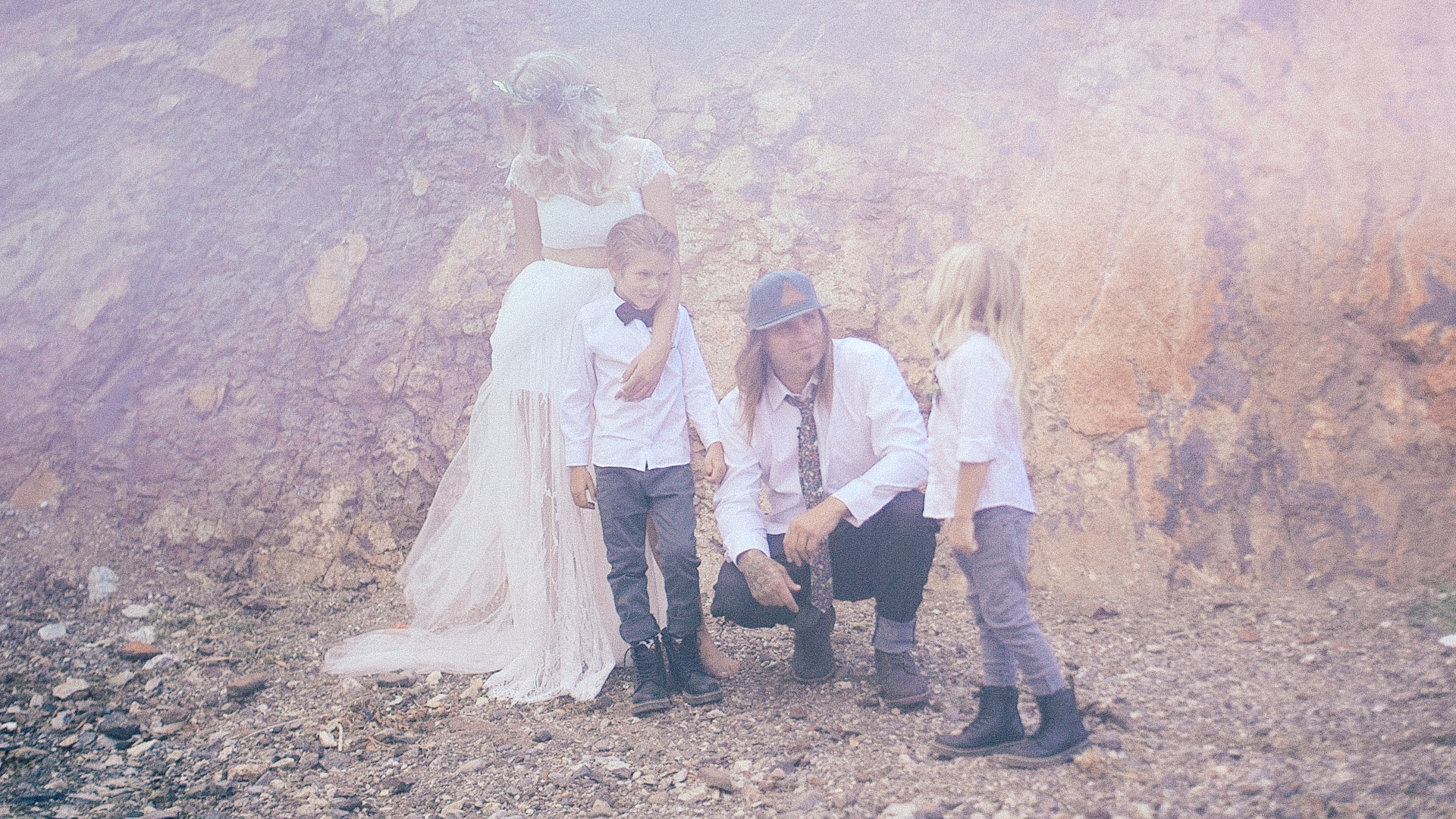 bride, groom and their two sons in the desert.