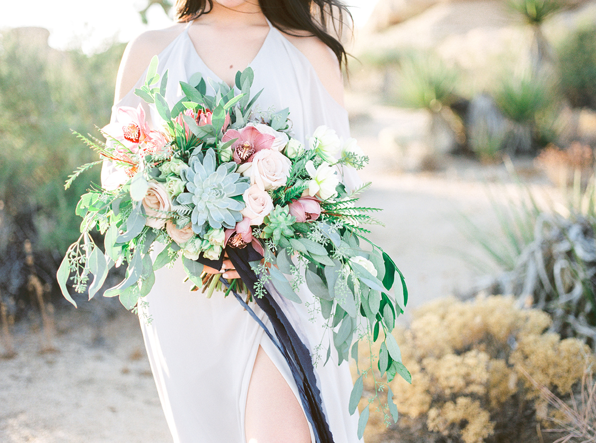 Bride holds bouquet at Joshua Tree Elopement